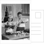 1950s two children playing doctor nurse by Corbis