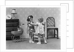 1940s two girls playing with dolls by Corbis