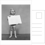 1940s blond toddler girl holding blank card sign by Corbis