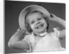 1950s child smiling little girl wearing pretty dress and straw hat by Corbis