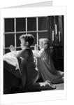 1950s two children praying kneeling night by Corbis