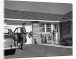 1950s family greeting father in driveway by Corbis