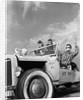 1950s teens in roofless hotrod with graffiti atom & eve no kissing etc. by Corbis