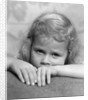 1930s portrait sad little blond girl peeking over her hands looking at camera by Corbis