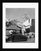 1950s child typing sitting at typewriter by Corbis