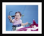 1960s smiling baby holding eyeglasses by Corbis
