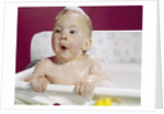 1960s wet baby in bath making funny face by Corbis