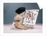 1960s baby artist wearing black beret sitting in front of easel painting by Corbis