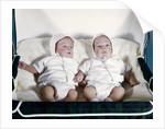1950s 1960s twin boys dressed in white lying in stroller side by side by Corbis