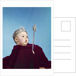 1960s baby dressed as royal queen in a velvet robe cloak cape rhinestone tiara crown and scepter wand by Corbis