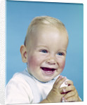 1950s 1960s happy laughing blond baby boy by Corbis