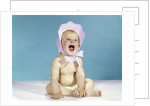1960s baby wearing pink checked bonnet laughing by Corbis