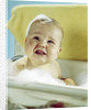 1960s smiling baby in bath looking up by Corbis
