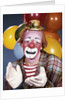1960s portrait of clown with a sad expression wearing tiny hat clapping his hands by Corbis