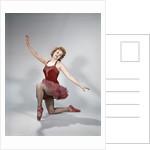 1960s teen girl red velvet costume pink net tutu kneeling ballet dance pose bow by Corbis