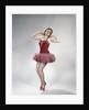 1960s teen girl woman red velvet costume pink net tutu fishnet stockings dance pose en pointe by Corbis