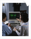 1980s couple working at apple iii 3 home computer paying bills by Corbis