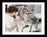 1960s woman electronics factory worker assembling television color gun for television picture tube by Corbis