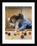 1980s teen couple playing pool by Corbis