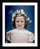 1940s portrait smiling little girl wearing yellow and white crown of daisy flowers by Corbis