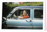 1950s woman driver looking out of car window by Corbis