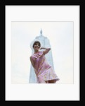 1960s young woman print miniskirt dress summer hat in front empire state building new york city by Corbis