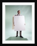 1960s smiling man wearing blank sandwich board by Corbis