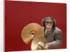 1960s chimpanzee wearing suit and tie playing cymbals by Corbis