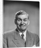 1950s mature middle aged man smiling business suit tie happy amused funny face expression by Corbis