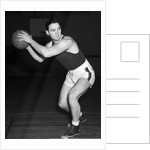1930s teen boy playing basketball holding ball standing in position by Corbis