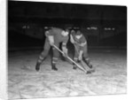 1940s 1950s ice hockey players fighting for the puck by Corbis