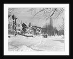 1940s suburban winter scenic street houses and cars covered in snow by Corbis