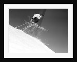 1950s man skier skiing down slope jumping into air by Corbis