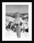 1940s 1950s young blond athletic woman looking at camera smiling standing with ski poles top of mountain by Corbis