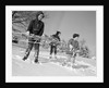 1960s three boys holding sleds looking downhill by Corbis