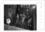 1950s couple man woman wearing sweaters talking in ski lodge by fireplace view from above by Corbis