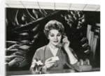 Woman Office Worker on the Phone Distracted by Noise. by Corbis