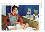 1940s Mother with Her Baby on a Changing Table in a Nursery. by Corbis