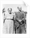 Grandma and Grandpa pose in the backyard, ca. 1955. by Corbis