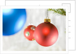 Close-up of hanging red and blue Christmas baubles by Corbis