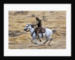 Cowboy riding the range by Corbis