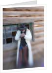 Cowboy lighting a cigarette by Corbis