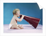 1960s Profile Of Seated Baby Shouting Yelling Speaking Into Big Megaphone by Corbis