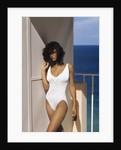 1990s Woman Wearing White Bathing Suit Looking At Camera by Corbis