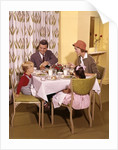 1950s/1960s Family Dining In Restaurant by Corbis