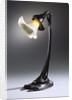 A rare wheel-carved glass and bronze table lamp by Corbis