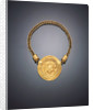 A Roman gold necklace, with a large central medallion featuring a repousse facing head of Medusa by Corbis