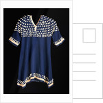 A Hunkpapa Sioux girl's dress of blue wool cloth trimmed with cowrie shells by Corbis