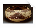 A fine and large Pomo gift basket of willow, redbud and sedge root with attached quail feathers and clam shells by Corbis