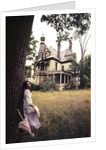 1960s 1970s Woman Standing Beside Tree Front Of Abandoned Haunted Victorian House by Corbis